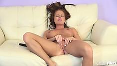 Nikki Delano moans as she reaches a powerful orgasm on camera