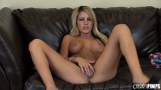 Holly gently caresses her clit which makes her body twist and turn with excitement