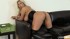 She sits and grabs her big titties and shows off her ass on the couch