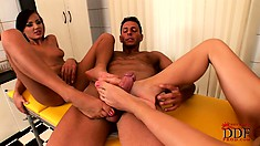 Threesome foot fetish fun as they slip his dick between them