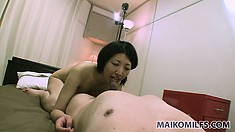 The wild Asian cougar gets pounded doggy style and relishes every moment of it