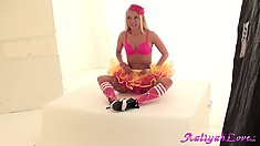 Blonde ballerina poses for the camera and does a little dance