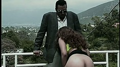 Horny redheaded MILF bangs her black pimp daddy out on a balcony
