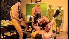 Hard-bodied soldiers perform a cock-inspection on their mates