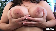 Voluptuous brunette touches her juicy tits and smooth pussy for the camera