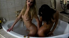 Cute lesbian couple makes sweet love during a nice and sexy bath
