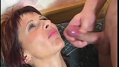 Mature redhead eats meat, gets fucked in both holes and gets a facial