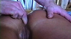 Sexy blonde lies on her belly on the bed and gets her tight ass pleased