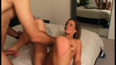 Dirty blonde with a fabulous ass lies on the bed and gets fucked hard
