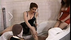Submissive dude is a sex slave for Misty Rain and Julia Parton