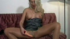 Horny blonde beauty uses an extra long toy to make herself moan