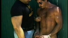 These two gay cops bring a perp to his knees and cum all over him