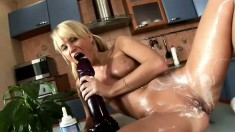 Beautiful blonde Michelle lubes herself up before some huge toy play