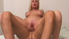 Pretty blonde slut with decent tits rides reverse cowgirl style