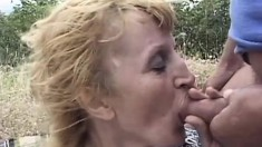Nasty blonde lady has two guys fulfilling her sexual fantasies in the outdoors