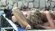 Striking Latina engages in passionate lesbian sex with a sultry blonde