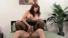 Mature redhead with a gigantic pair of knockers gets a shafting