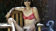 Oriental lady shows off her hairy peach and teases with a glass dildo
