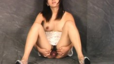 Striking Asian chick Yume shows off her perky ass and her hairy peach