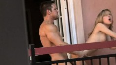 Ripped stud enjoys fucking a naughty young girl on the balcony