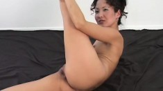 Hot babe with long legs Tiffany takes it all off and displays her twat