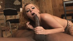 Fascinating redhead Sophie Dee stuffs a black pole deep inside her ass