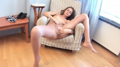 Sexy young Albina strokes her amazing pussy while wearing pantyhose
