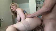 Big breasted blonde mature fucks a young stud's cock in every position