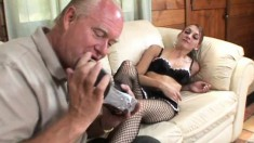 Grandpa gets a younger brunette to nibble on his prick and foot fuck him