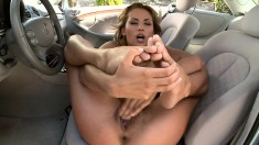 Mesmerizing babe licks her toes and makes herself cum hard in the car
