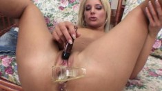 Crazy bitch shows her nice ass and pours milk into her twat and toys
