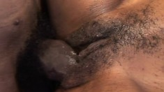 Exciting ebony girl Marie Luv takes a black shaft in her hairy peach