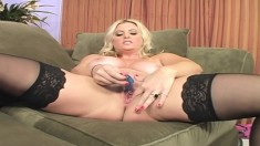 Stacked blonde Kayla Prettyman toys her pussy and fucks a black shaft