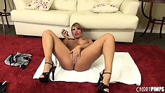 Ava stands and shows you her stuff and gets on the floor with her dildo