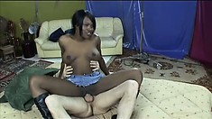 Black prostitute in high boots gets fucked hard by a big white dick