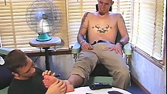 Handsome businessman gets his feet looked after by a horny twink