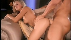 Dazzling blonde plays with her aching clit while a hard cock deeply invades her cunt