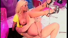 Blonde bombshells Jill Kelly and Tawny Roberts have fun with two studs