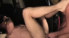 Long haired gay stud has a big dildo and a hard cock drilling his ass