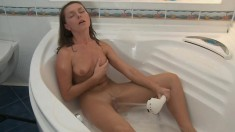 Horny slut gets her bald little cunt fucked hard in the bath