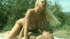 Long-haired blonde with huge boobs saves dude from nasty hard-on