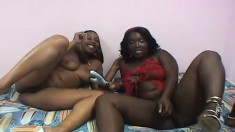 Two busty black mamas give each other some sweet chocolate loving