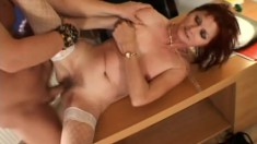 Redheaded MILF spreads her legs to let a co-worker satisfy her needs
