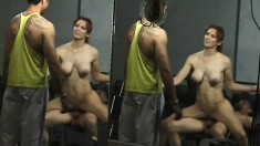 Nasty redhead needs to workout her fake tits at the gym and gets help for two horny guys