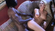 Busty blonde with sexy long legs has a massive black rod banging her juicy holes
