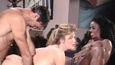 A black and blonde babe duo cross all barriers to play with a dick