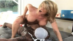 Kayla Quinn enjoys playing with a stiff black rod of pleasure