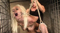 Kinky blonde with lovely tits gets her hot body tied up and suspended