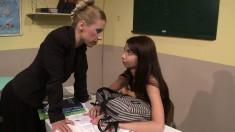 Cute young girl plays out her bondage fetish fantasy in the classroom