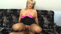 Saucy blonde MILF wears sexy black stockings while getting banged